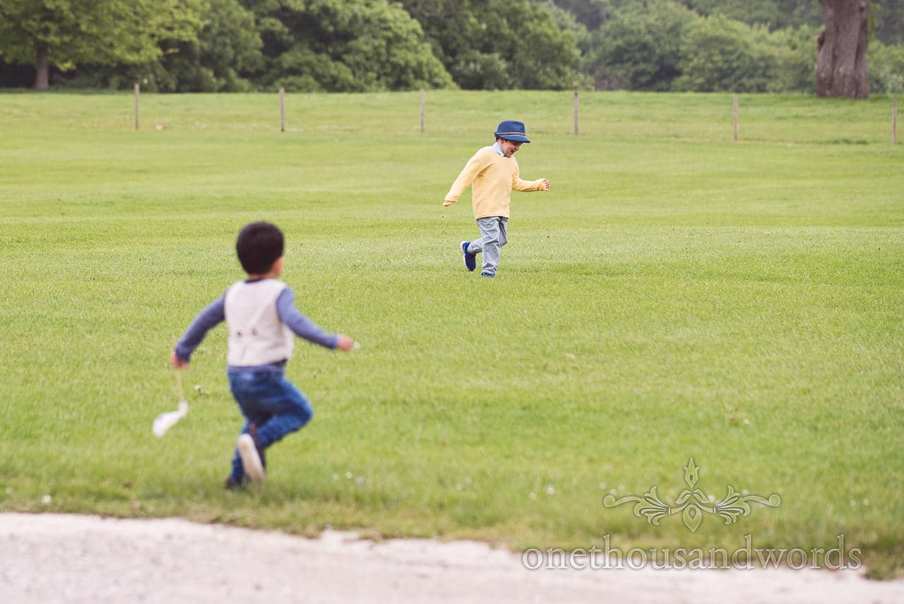 Children play in the grounds of Lulworth Castle wedding venue in Dorset