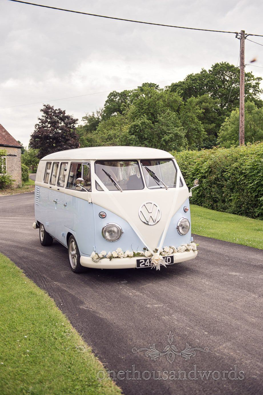 Classic blue and white VW split screen wedding transport at rustic wedding