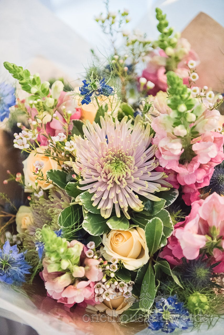 Colorful bridal bouquet on morning of Lulworth castle wedding