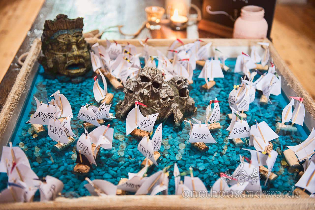 Cork ships in pool with skull rocks at pirate theme wedding