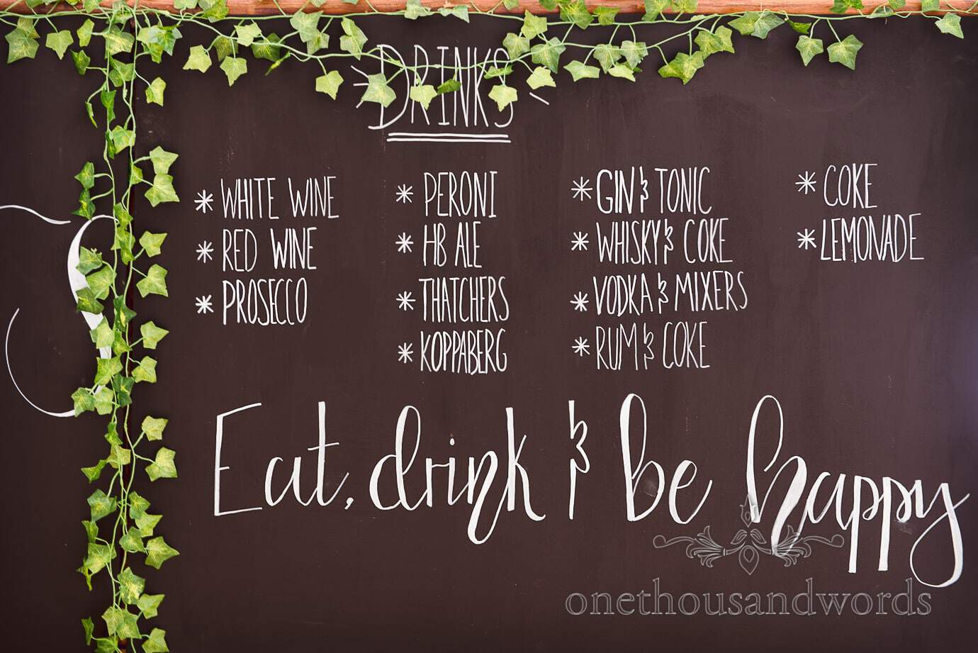 Country wedding bar menu on chalkboard with ivy Eat Drink & Be Happy sign