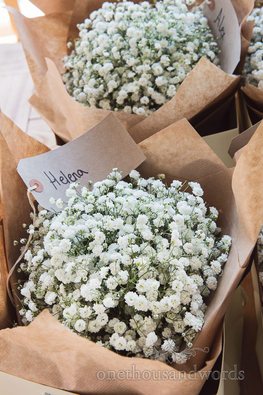 country wedding bouquets with gypsophila wrapped in brown paper with name tag