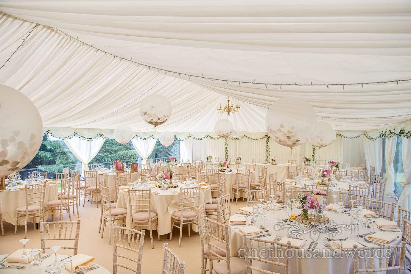 Country Wedding Marquee with pink details, large white balloons and ivy decorations