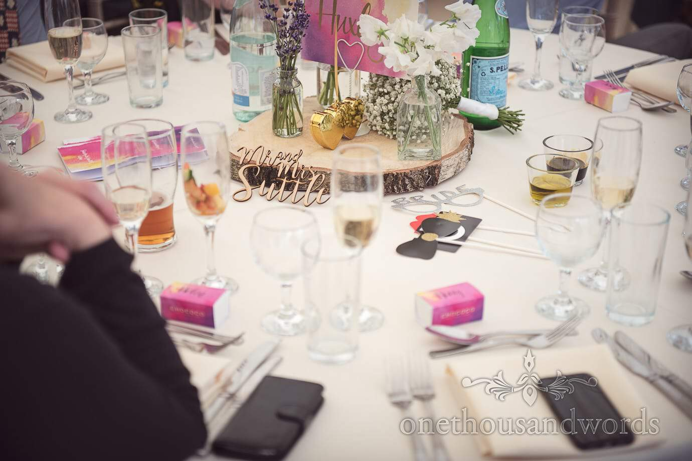 country wedding table decorations with wooden sign and gold love hearts