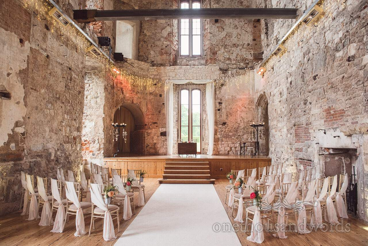 Decorated ceremony room at Lulworth castle wedding