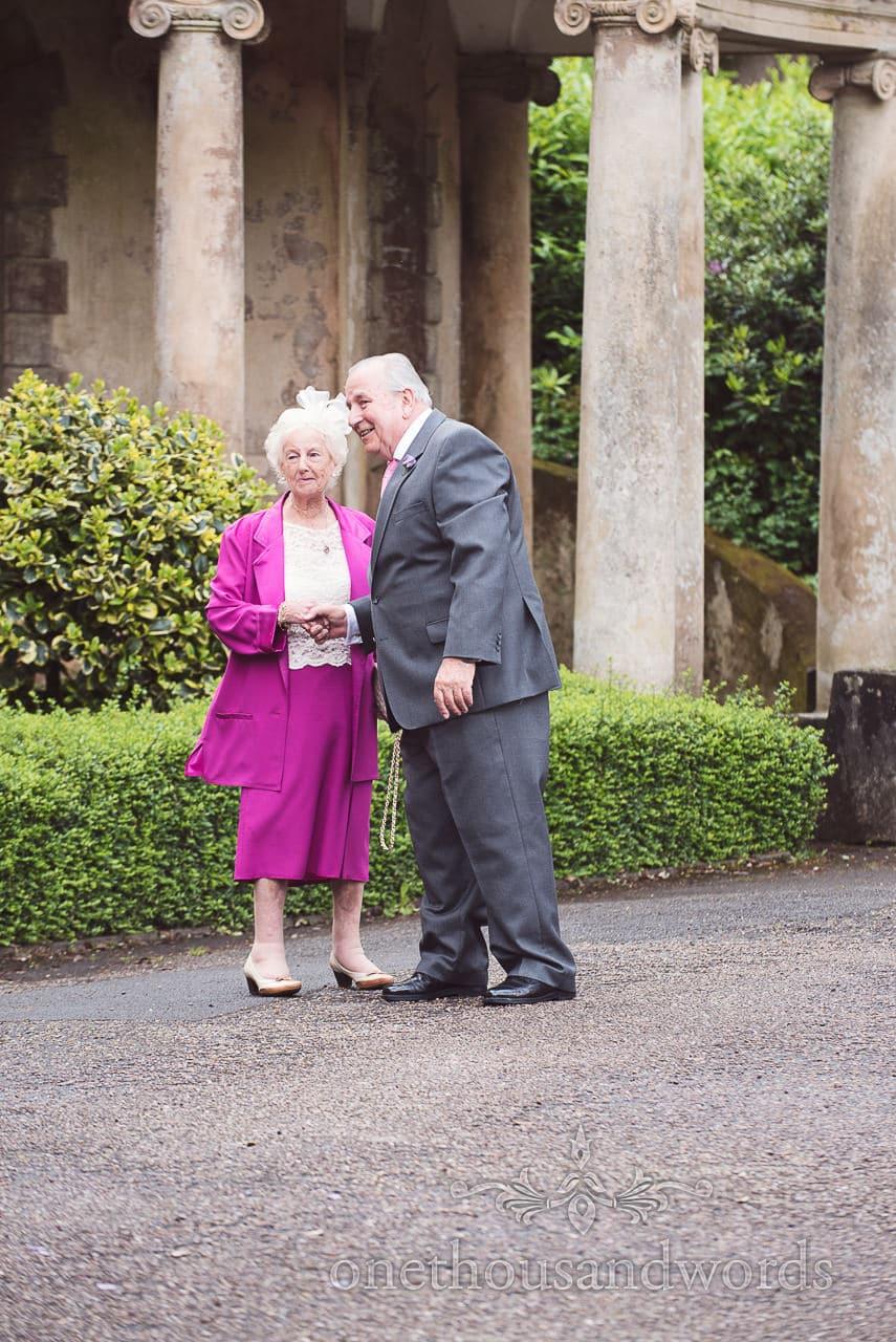 Elderly wedding guests next to stone columns at Upton House wedding