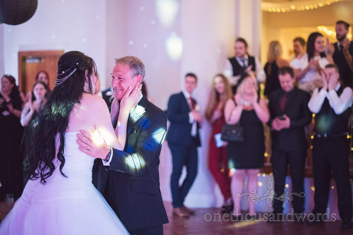 Emotional embrace during Father of the bride dance at Haven Hotel wedding