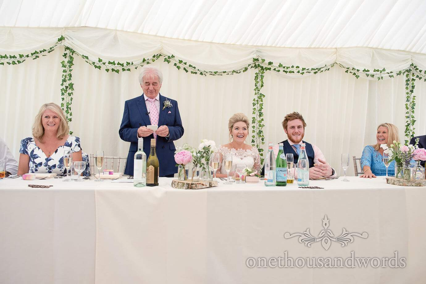 Father of the bride's wedding speech at country wedding in white marquee