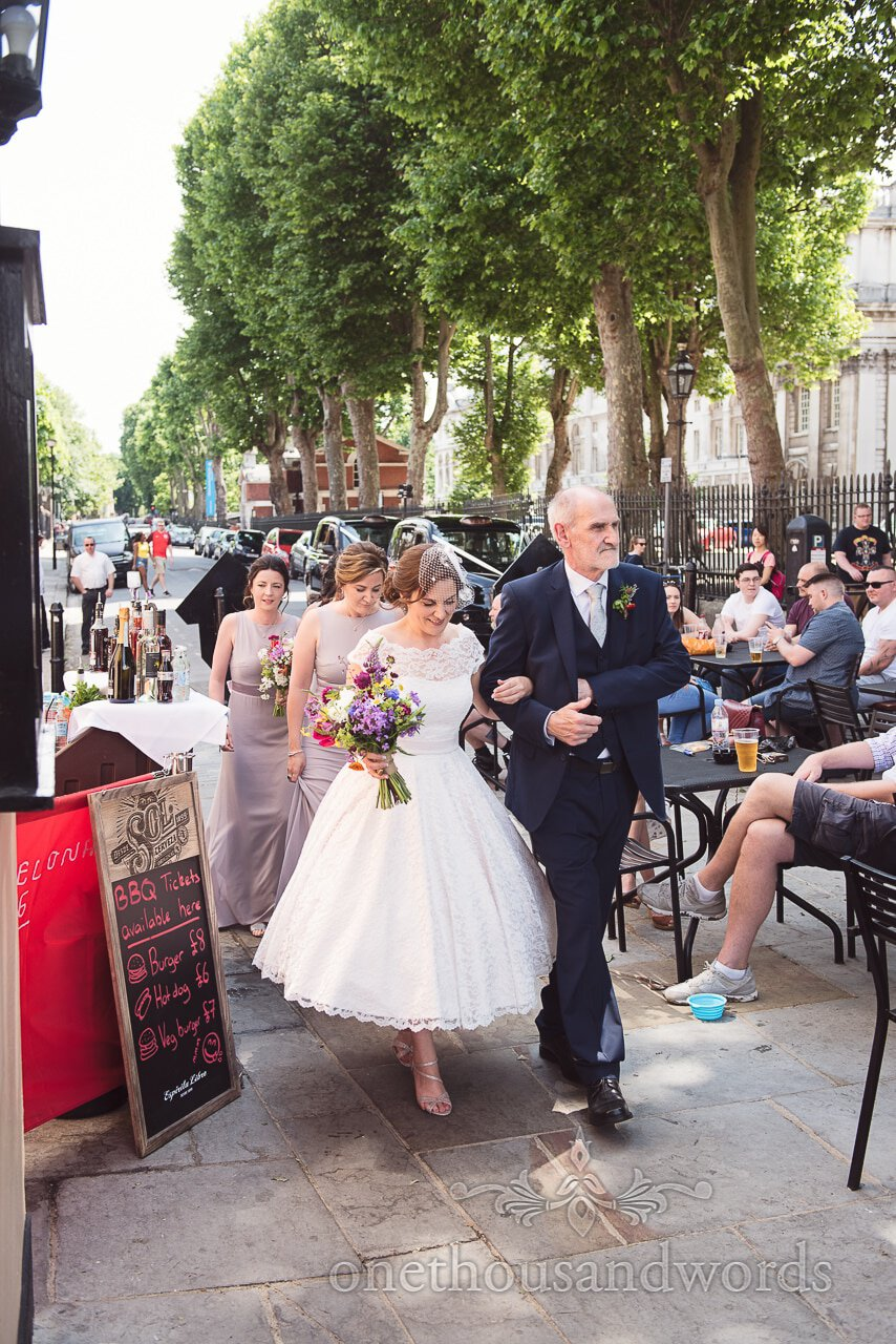Father of the bride arrives with bride and bridesmaids outside Trafalgar Tavern Wedding venue
