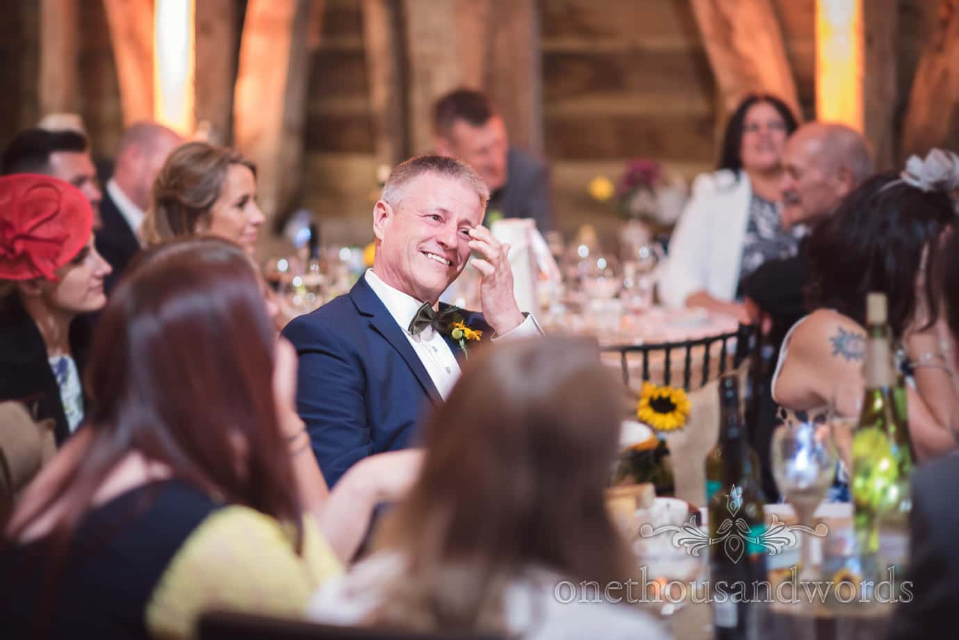 Father of the bride reacts to groom speech at rustic barn wedding