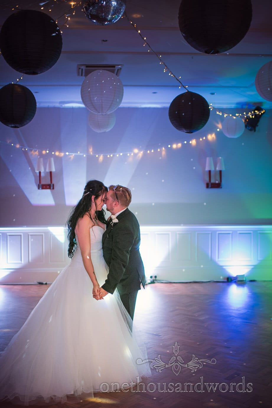 First dance at black and white themed rock and roll wedding under Chinese lanterns