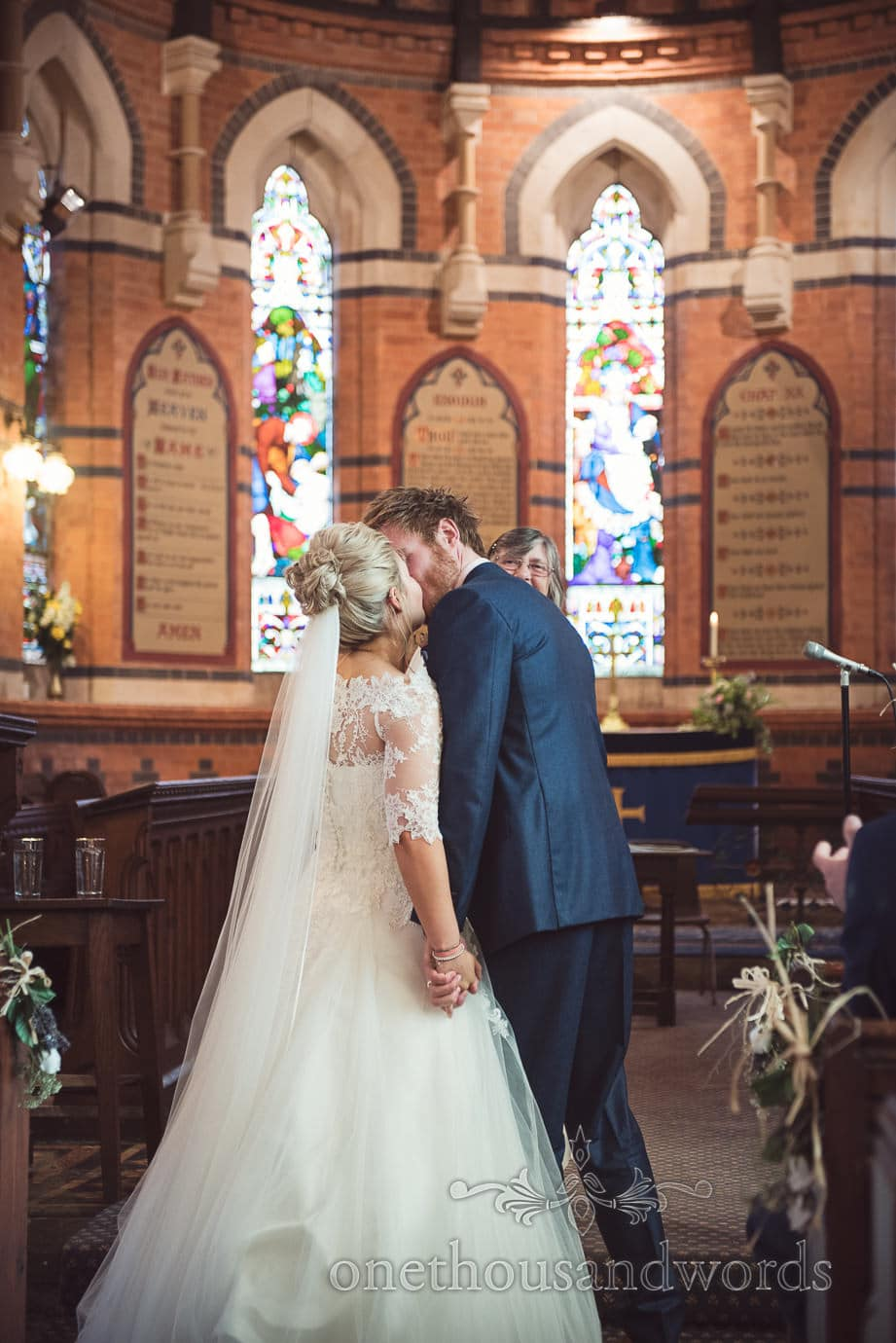 First kiss at red brick church wedding ceremony in Tur Langton Leicestershire