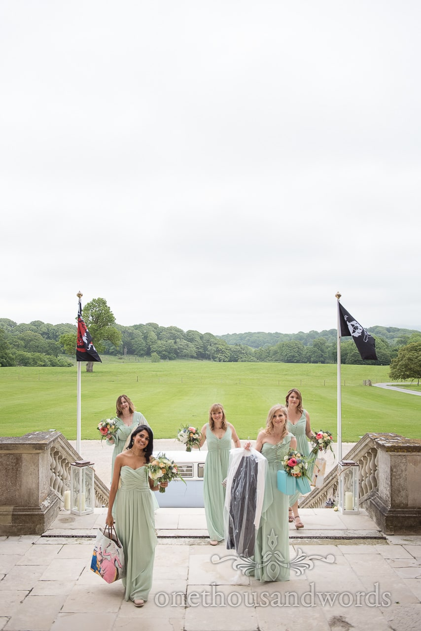 Five bridesmaids arrive at Lulworth castle wedding