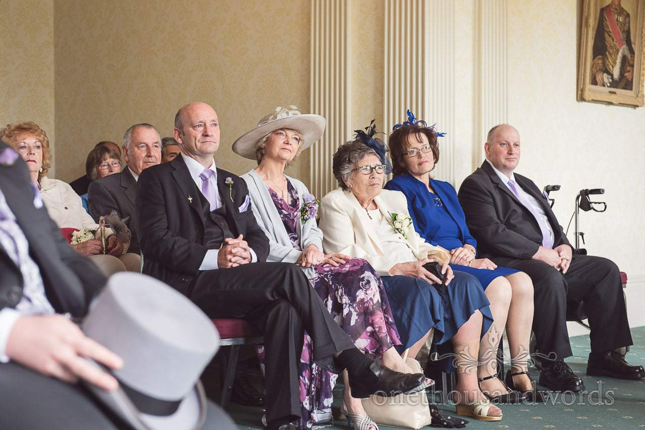 Friends and relatives watch Upton House wedding ceremony in Poole Dorset