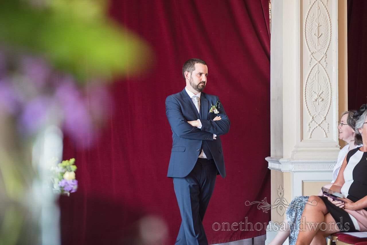 Greenwich Wedding Photographs of anxious groom waiting at Trafalgar Tavern wedding