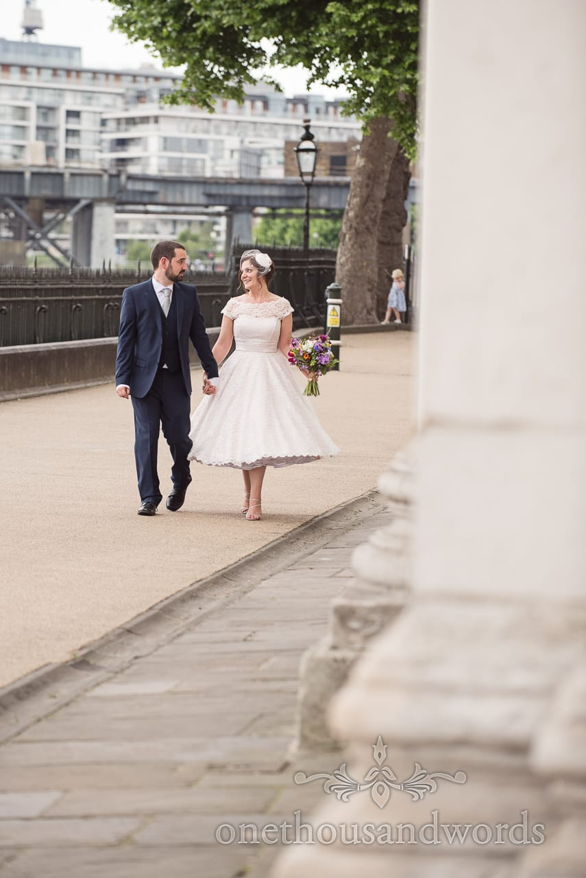 Greenwich Wedding Photographs of bride and groom walking alongside the Thames river