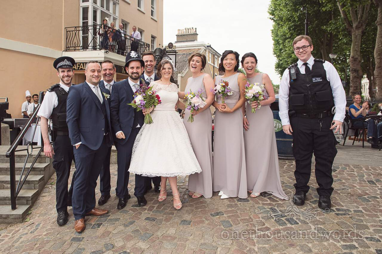 Greenwich Wedding Photographs of wedding party with policemen at Trafalgar Tavern