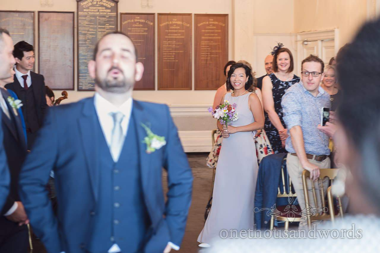 Groom breathes through his nerves as bridesmaid enters Greenwich wedding ceremony