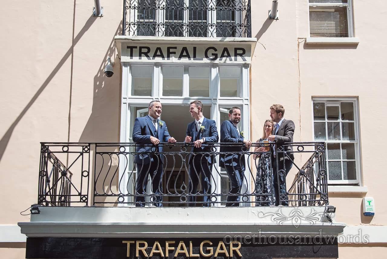 Groom, groomsmen and wedding guests on Balcony before Trafalgar Tavern wedding