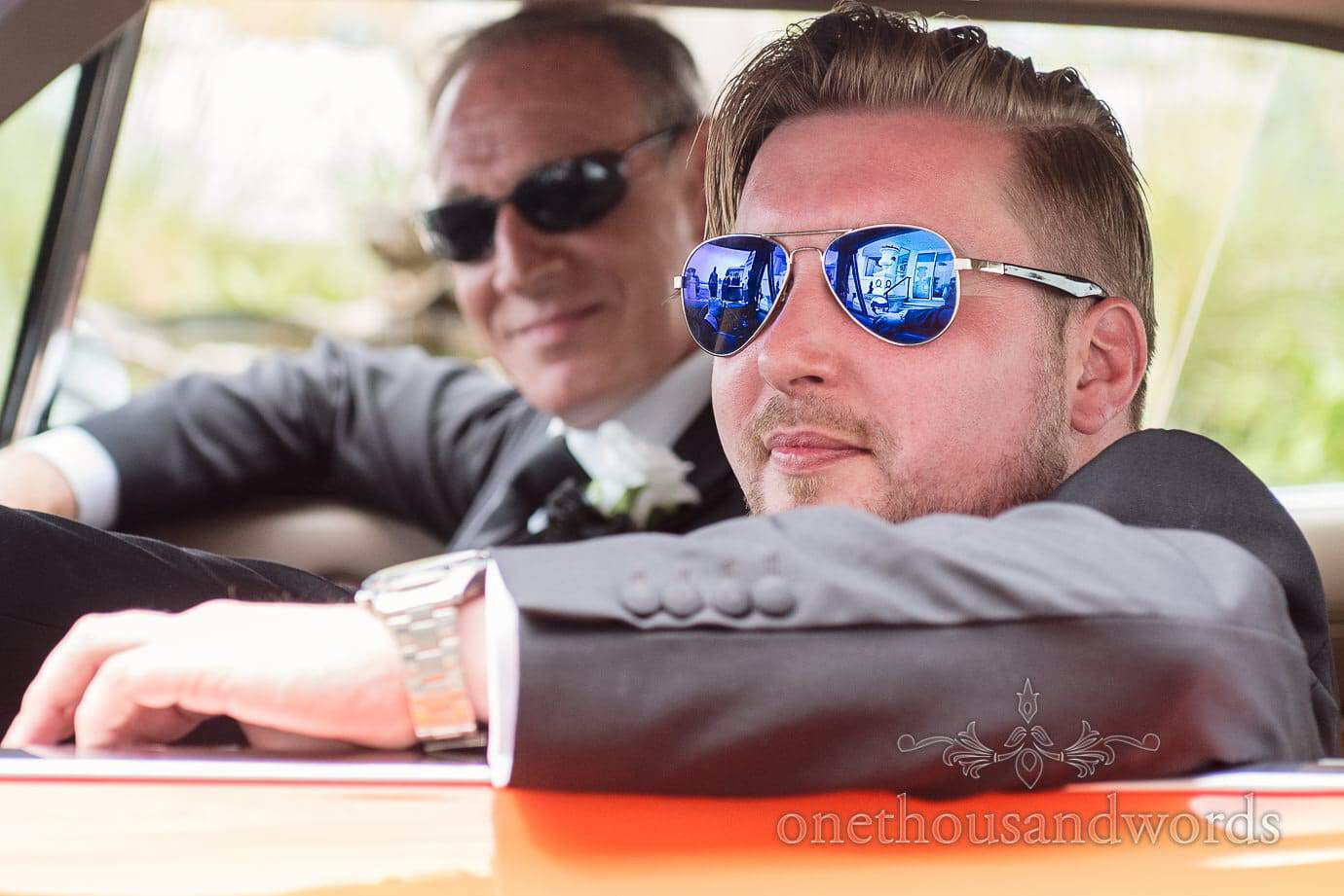 Groom in Blue Sunglasses drives The General Lee wedding car