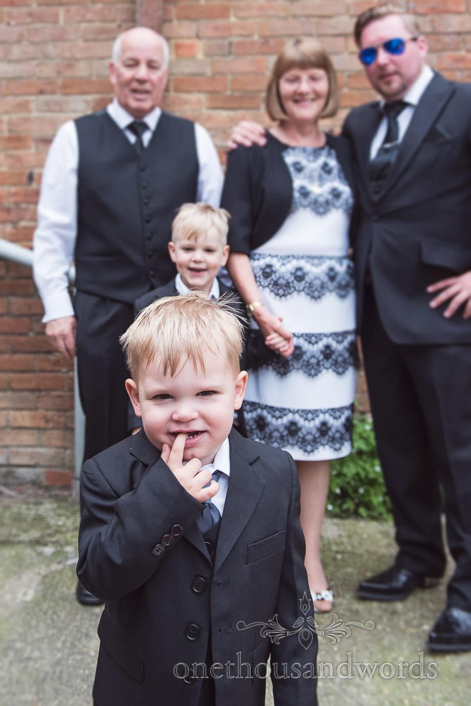 Groom's son takes over family wedding photograph on wedding morning in Dorset