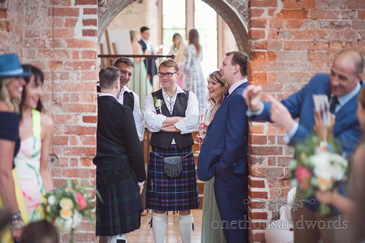 Groomsman in Jacobian shirt, waistcoat and kilt at Lulworth Castle kilted wedding
