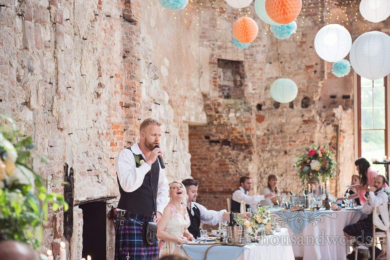 Groomsman in kilt makes wedding speech at Lulworth Castle wedding in Dorset