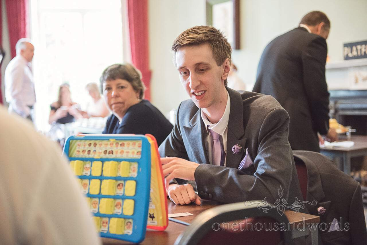 Groomsman plays guess who at Upton House wedding in Poole