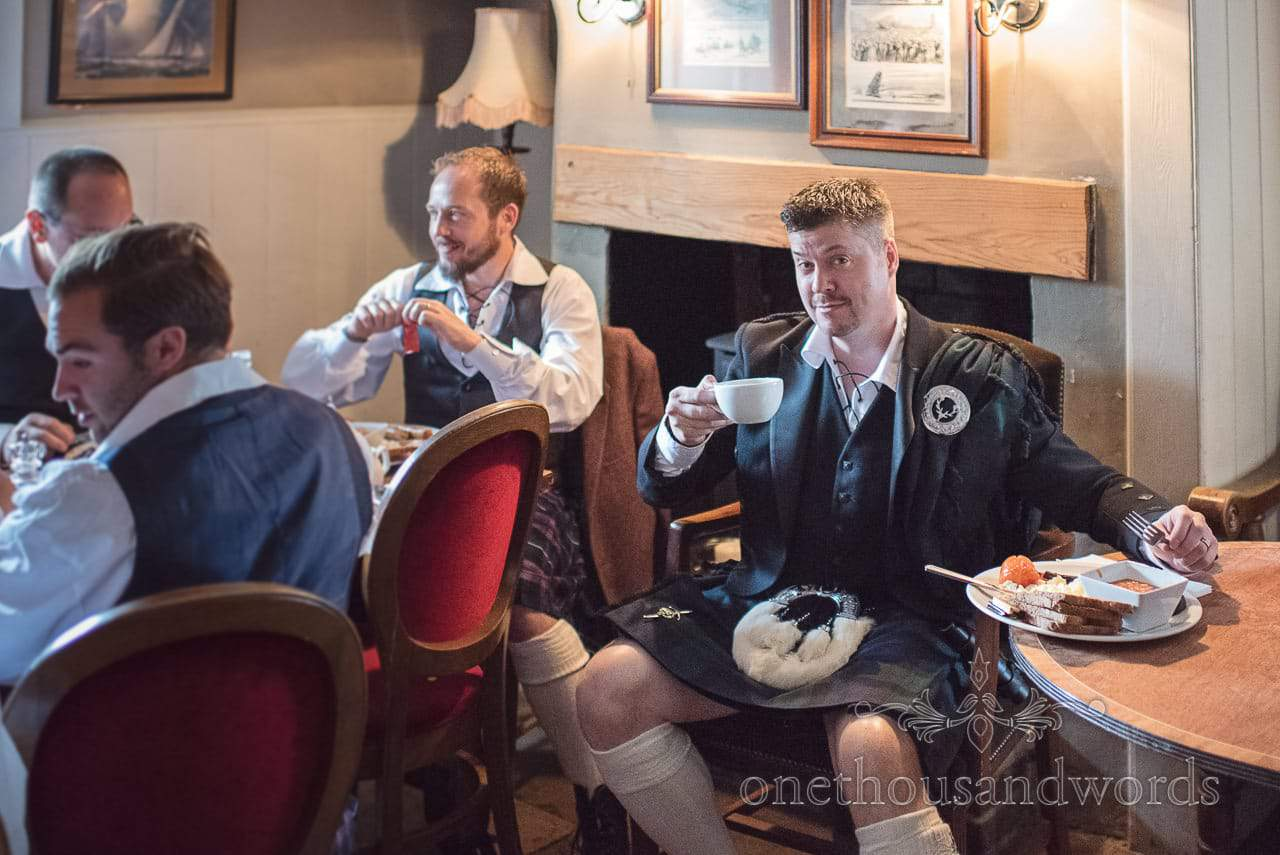 Groundsmen groomsmen enjoy a hearty breakfast before Lulworth castle wedding