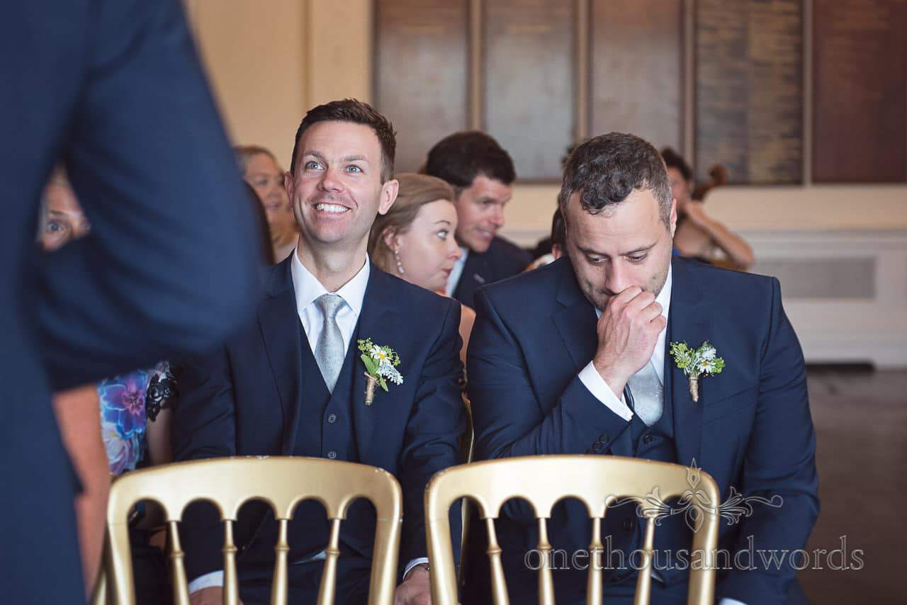 Happy and nervous groomsmen in blue wedding suits at Greenwich wedding ceremony photographs
