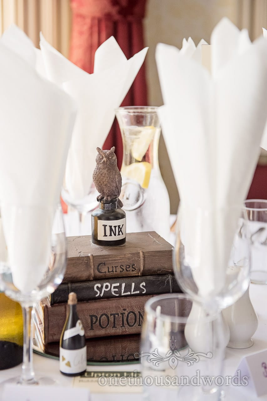 Harry Potter themed books, ink and owl wedding table decorations