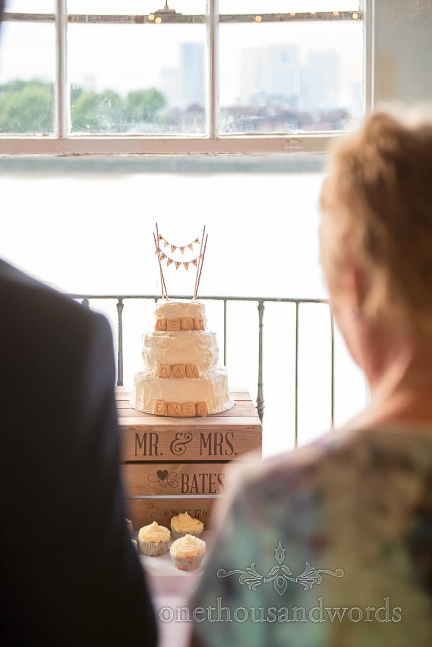 Home made wedding cake with scrabble biscuit lettering and mini bunting on personalised crate
