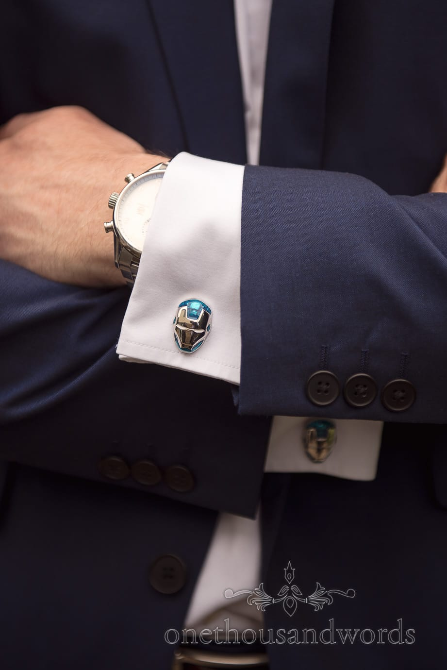 Iron man wedding cufflinks with grooms man's blue wedding suit and watch