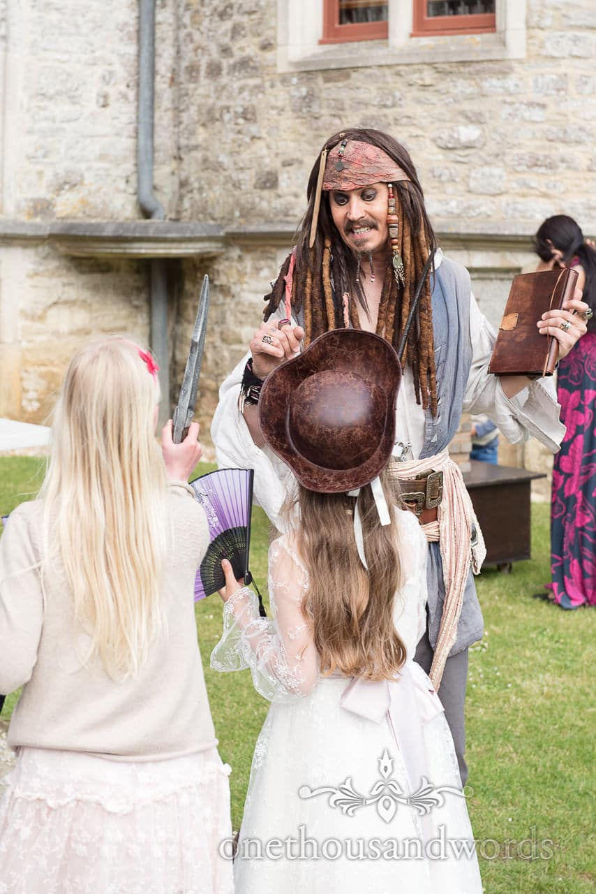Jack Sparrow talks to child wedding guests at pirate themed wedding