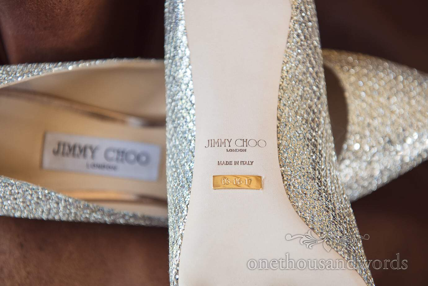 Jimmy Choo custom silver bridal wedding shoes with golden date plate