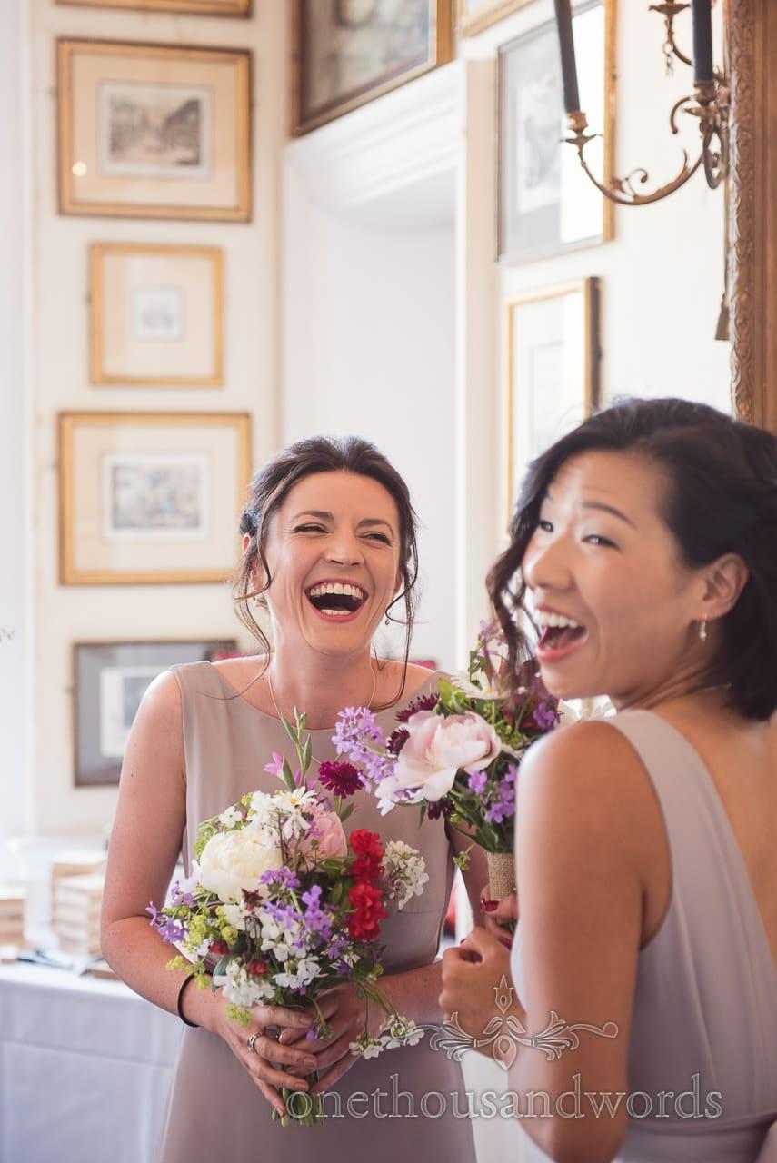 Laughing bridesmaids before ceremony at Trafalgar Tavern Wedding venue