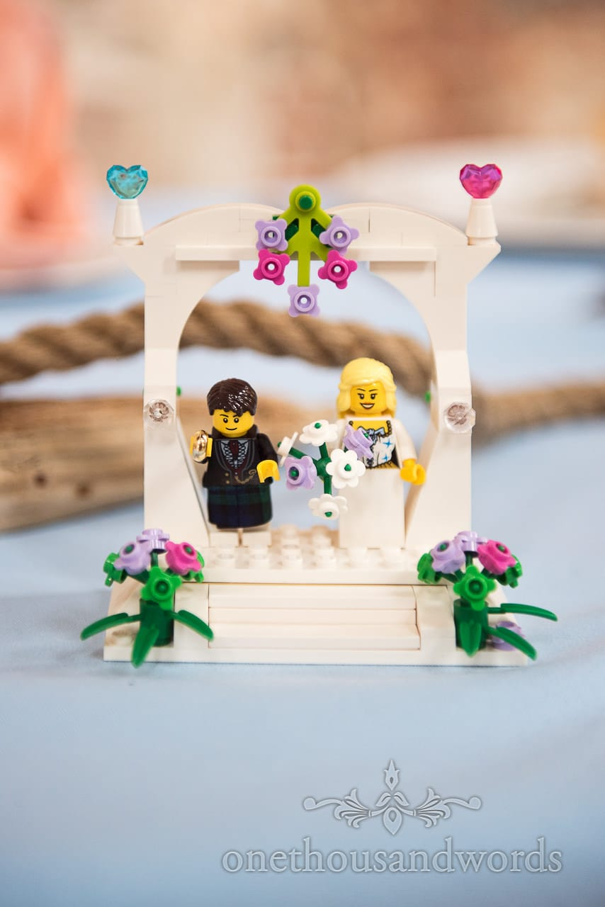 Lego bride and groom table decoration at Lulworth castle wedding