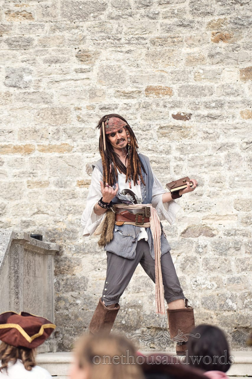 Melo Sparrow as Captain Jack Sparrow at pirate themed wedding with fancy dress