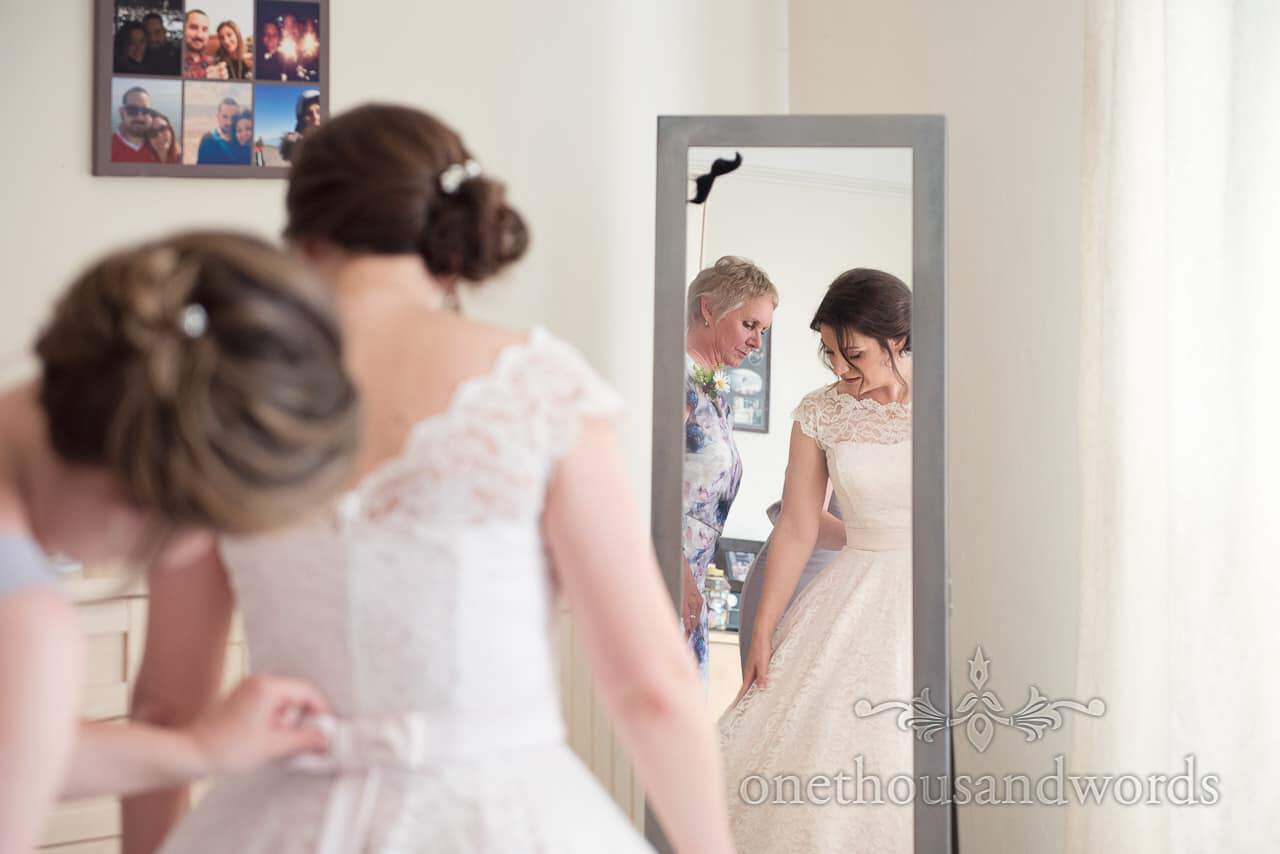 Mother and bride in mirror on morning of Greenwich wedding photographs