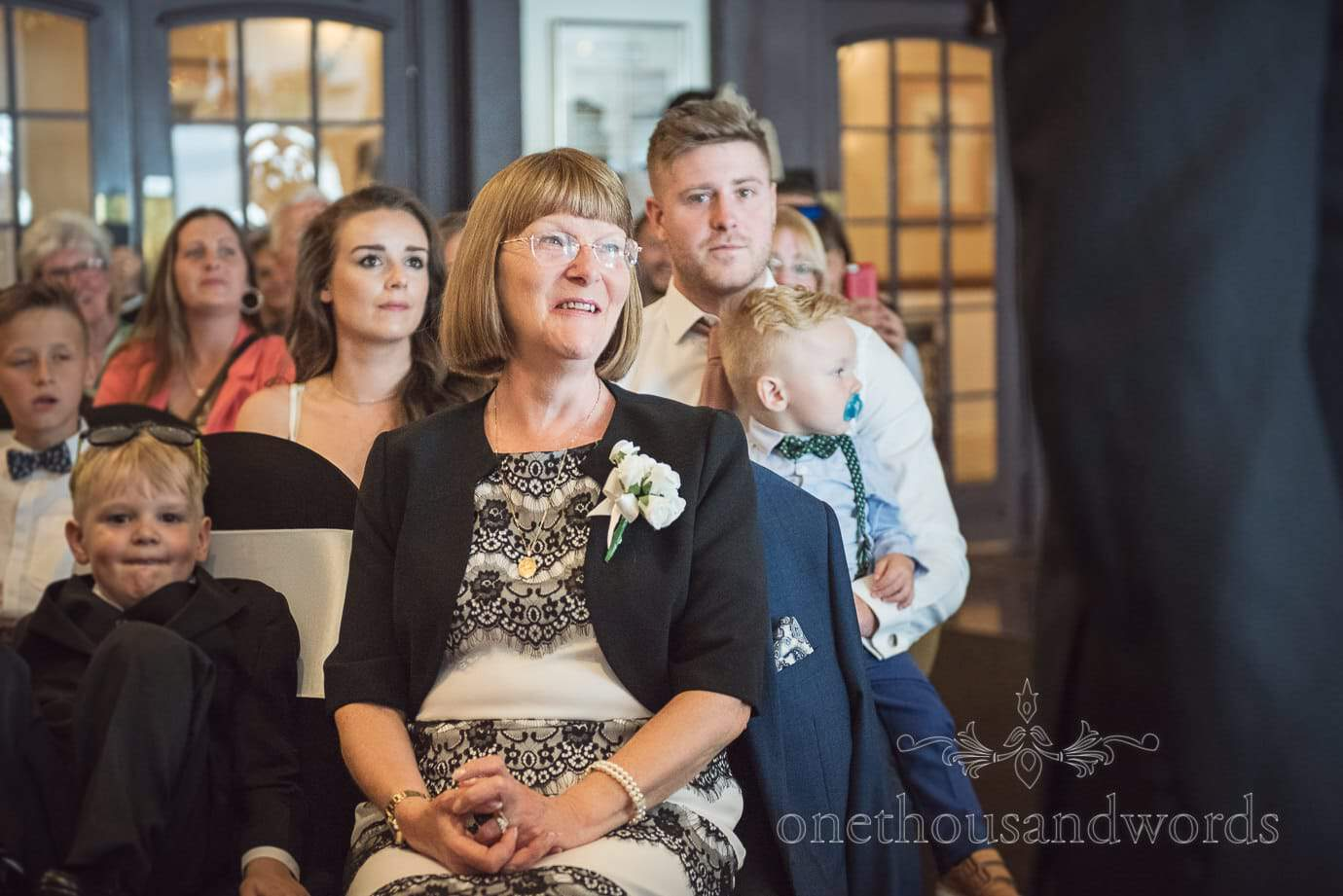 Mother of groom in Black and white watches wedding ceremony at Haven Hotel