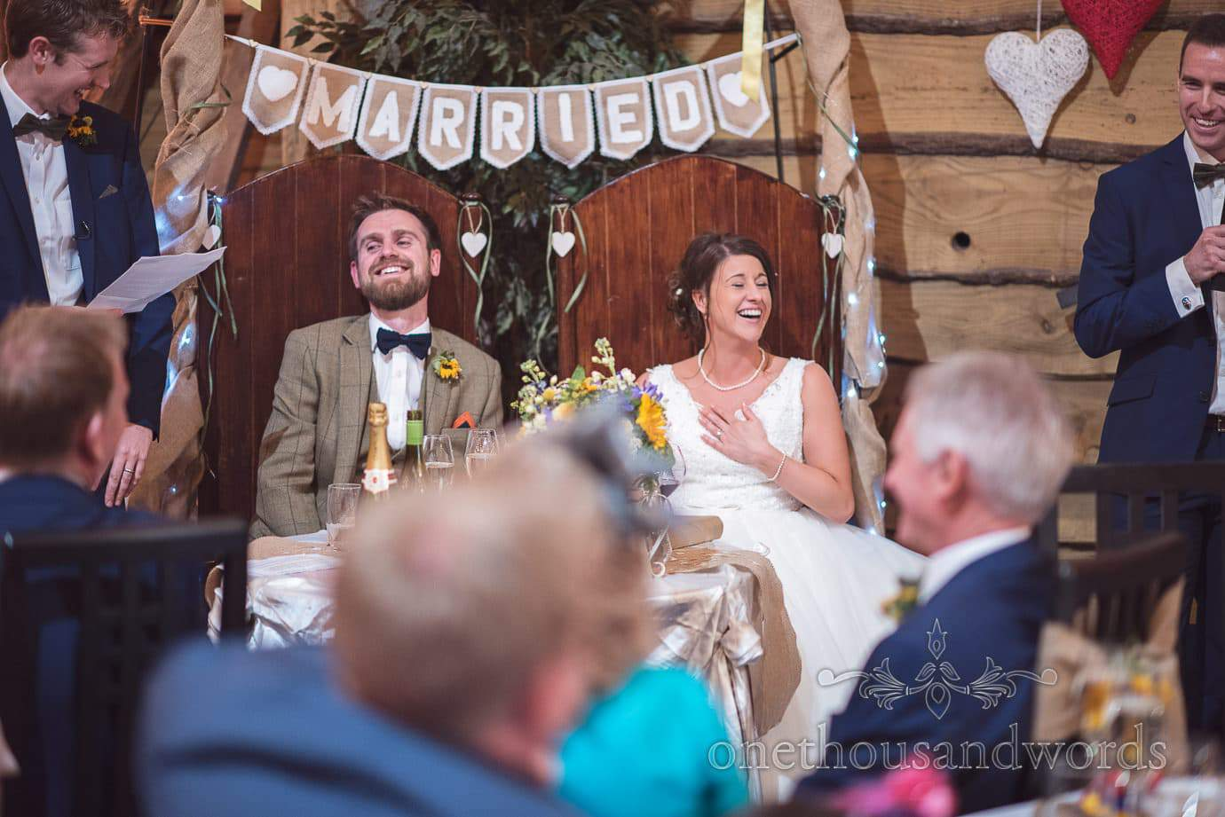 Newlyweds react to best men speech at rustic barn wedding
