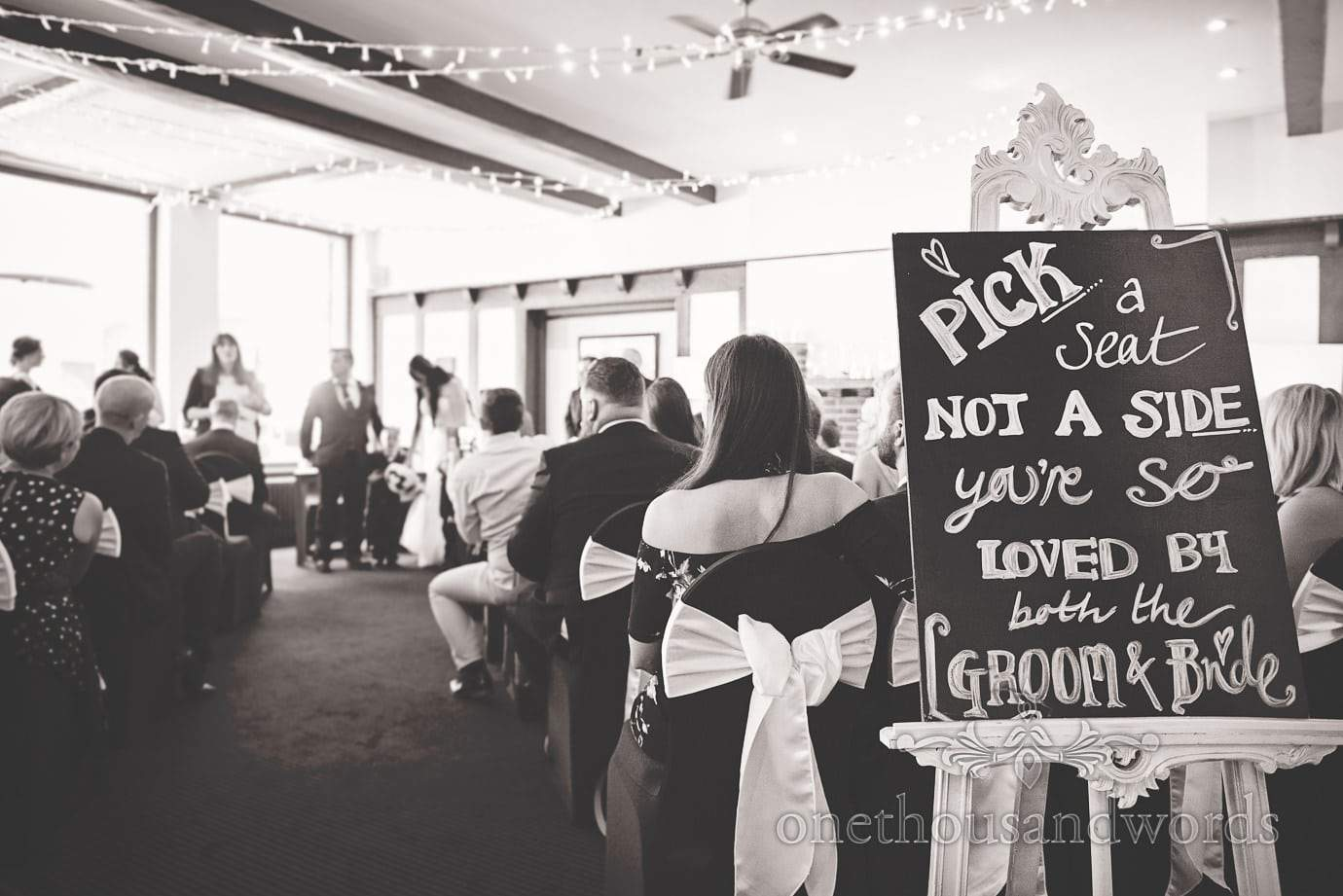 Pick a seat not a side you're so loved by the groom and bride sign