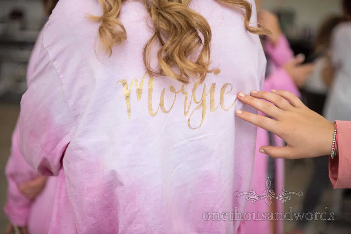 Pink bridesmaids dressing gown with gold script name lettering on back