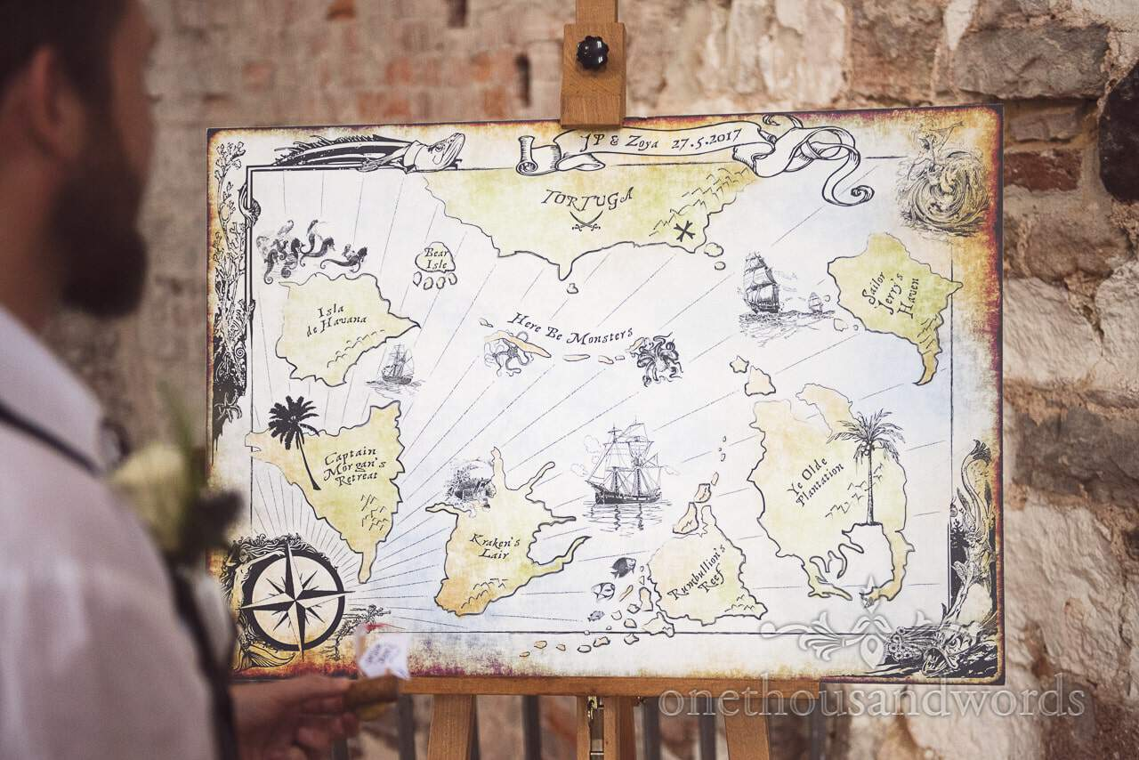 Pirate treasure map table plan at pirate themed wedding photograph