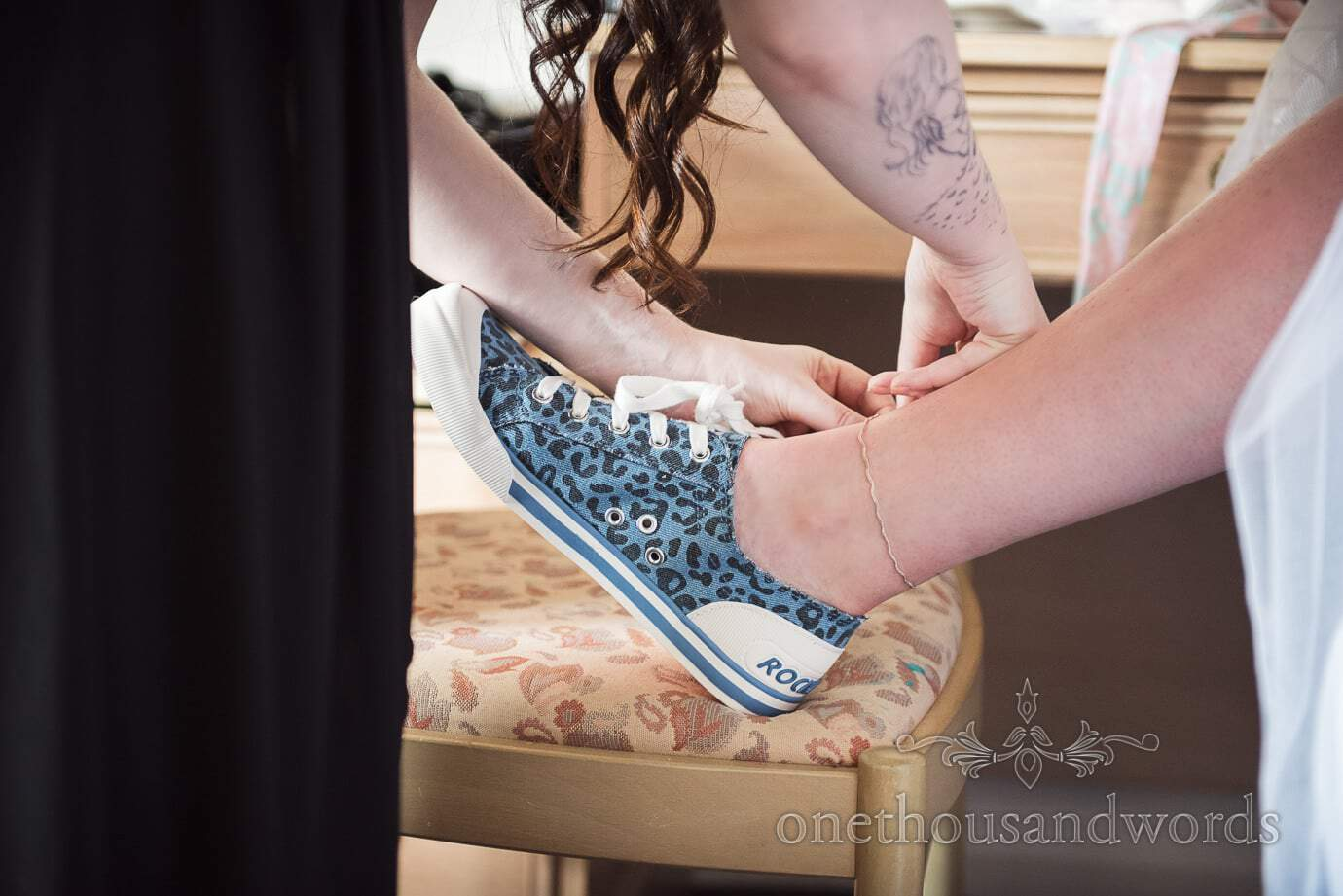 Rock and roll bride wears Jazzin Blue Animal Print trainers and ankle bracelet