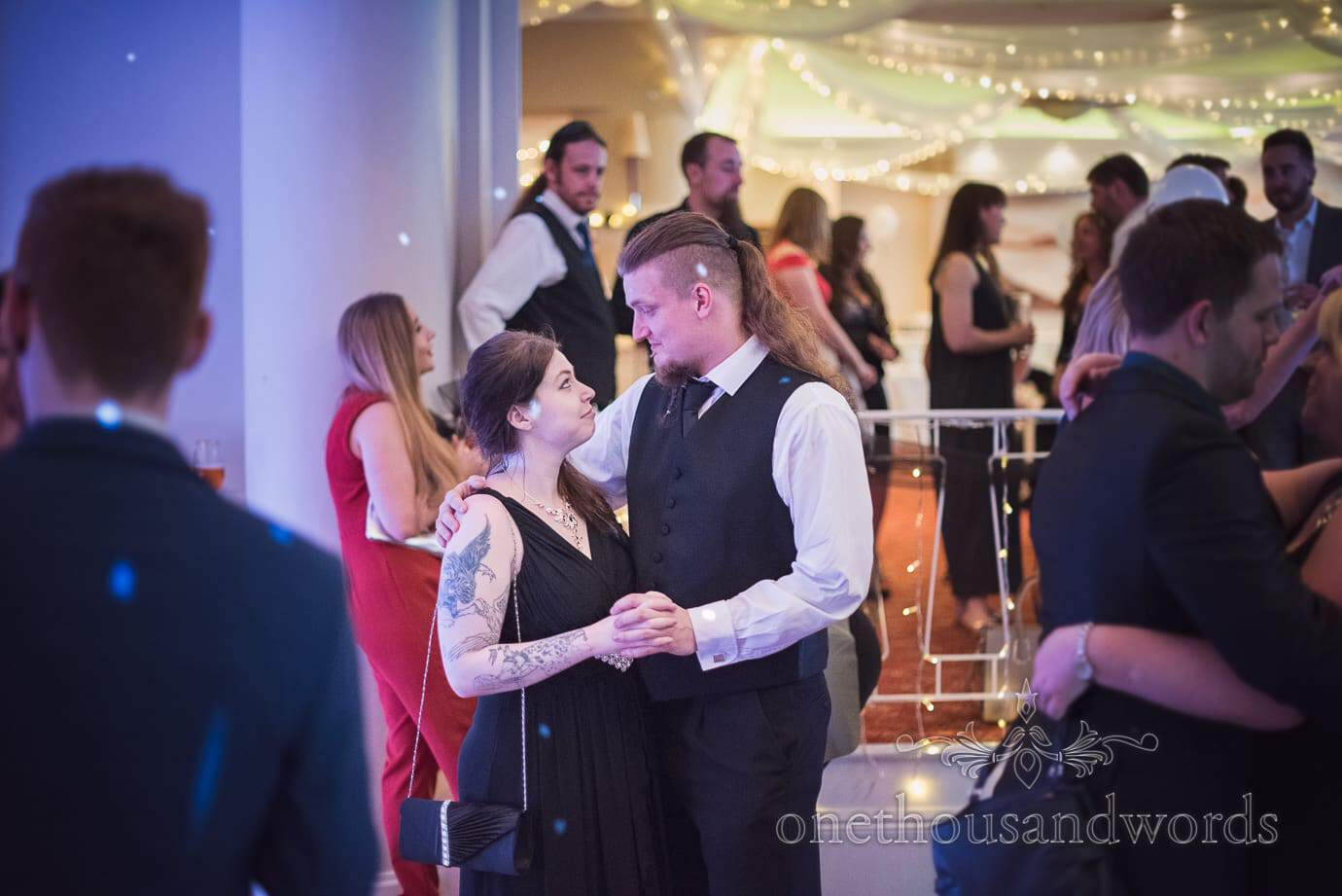 Rock and Roll wedding guests in black and white with tattoos dancing at Haven Hotel wedding