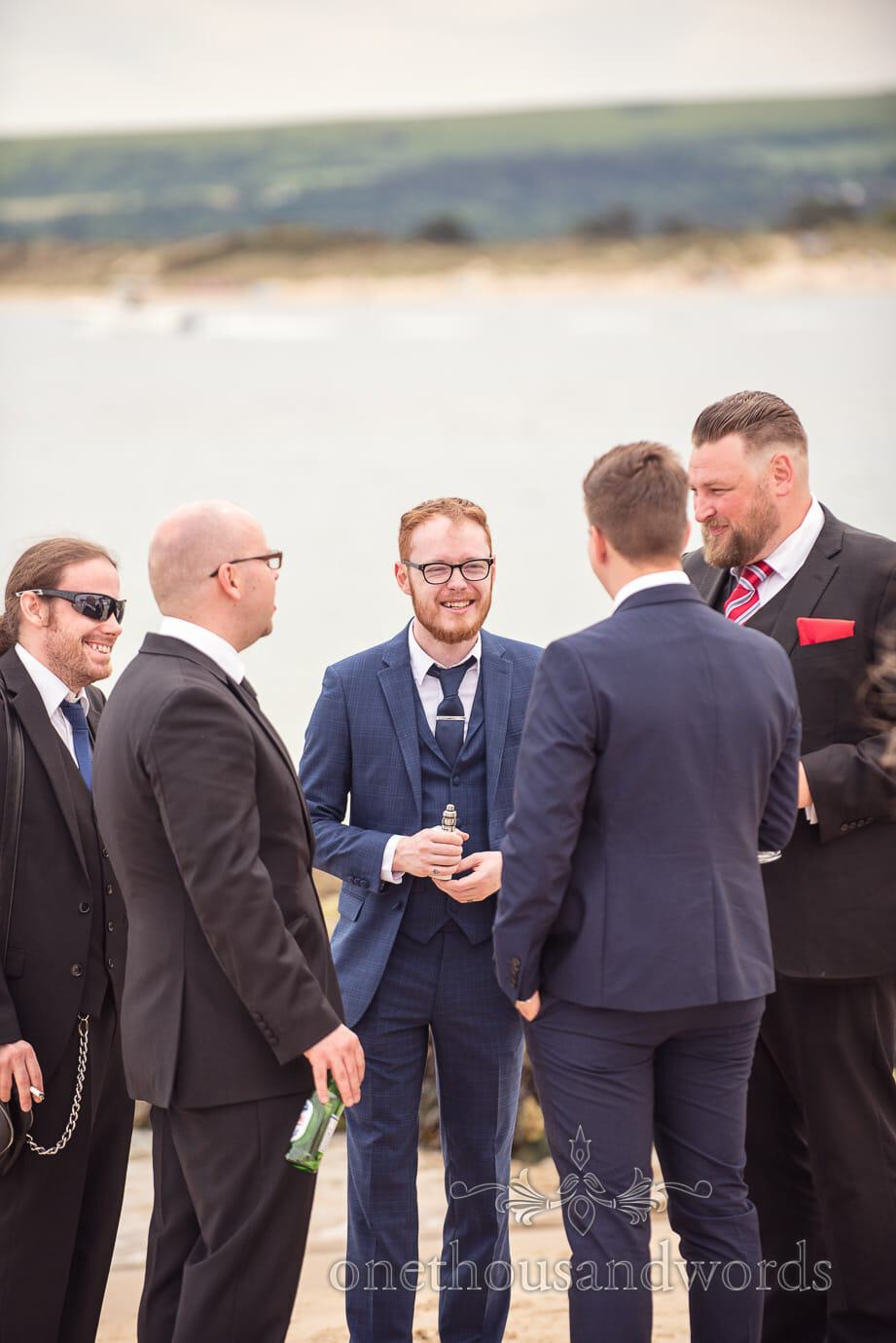 Rock and Roll wedding guests on beach at Haven Hotel by the sea in Sandbanks, Dorset