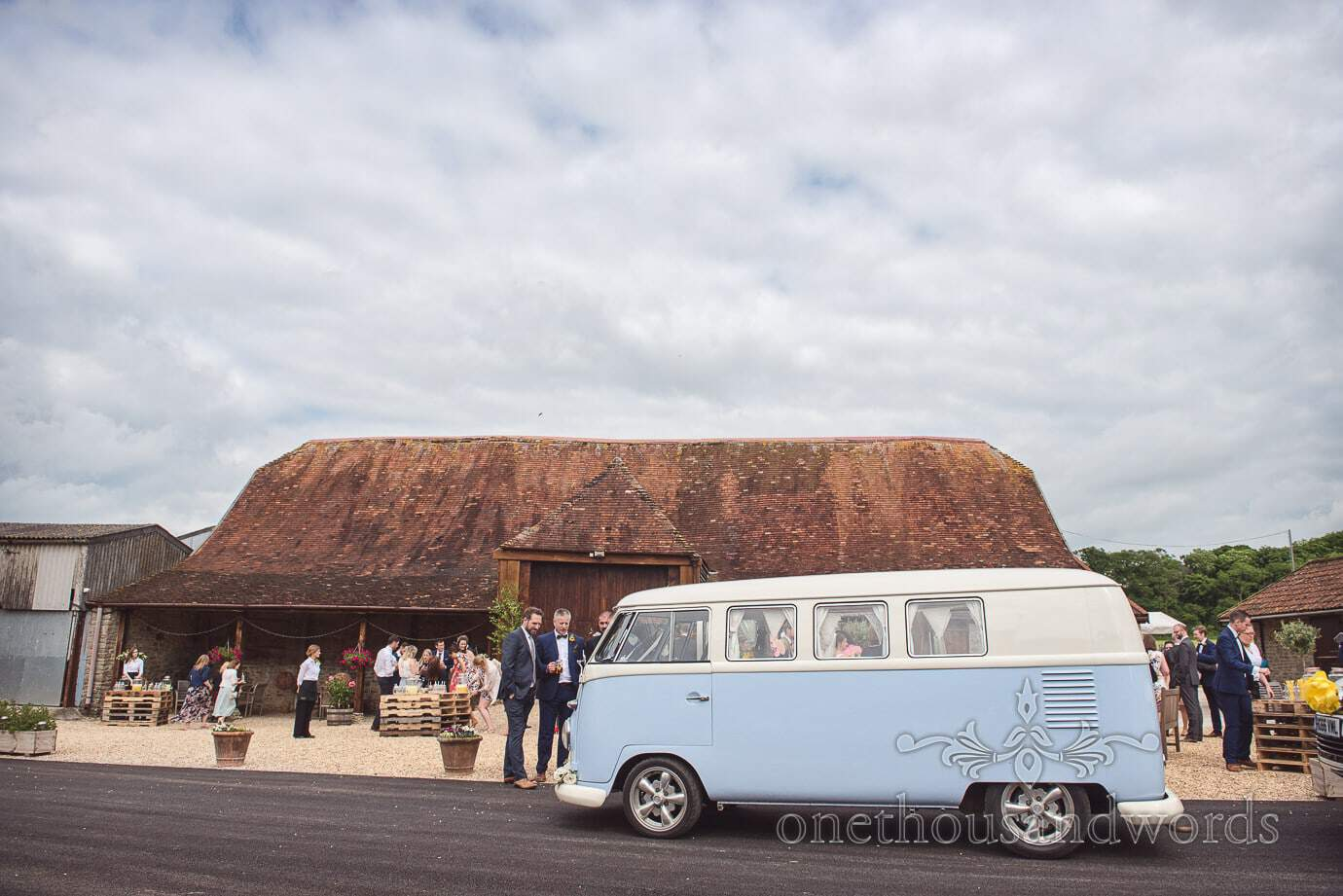 Stockbridge Farm Barn rustic wedding venue in Dorset with classic VW split screen van