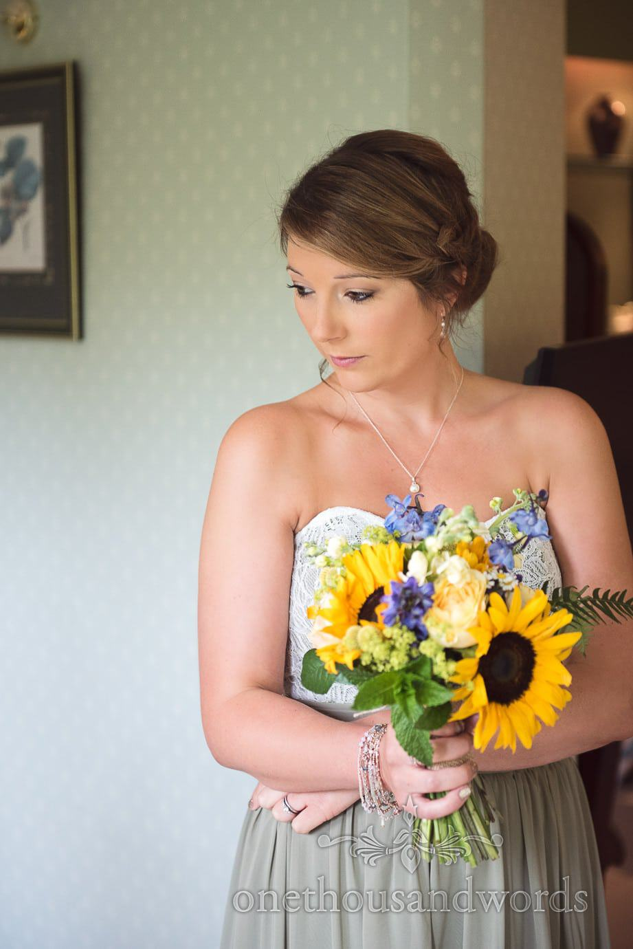 Stunning bridesmaid in green dress with summer flowers wedding bouquet with sunflowers
