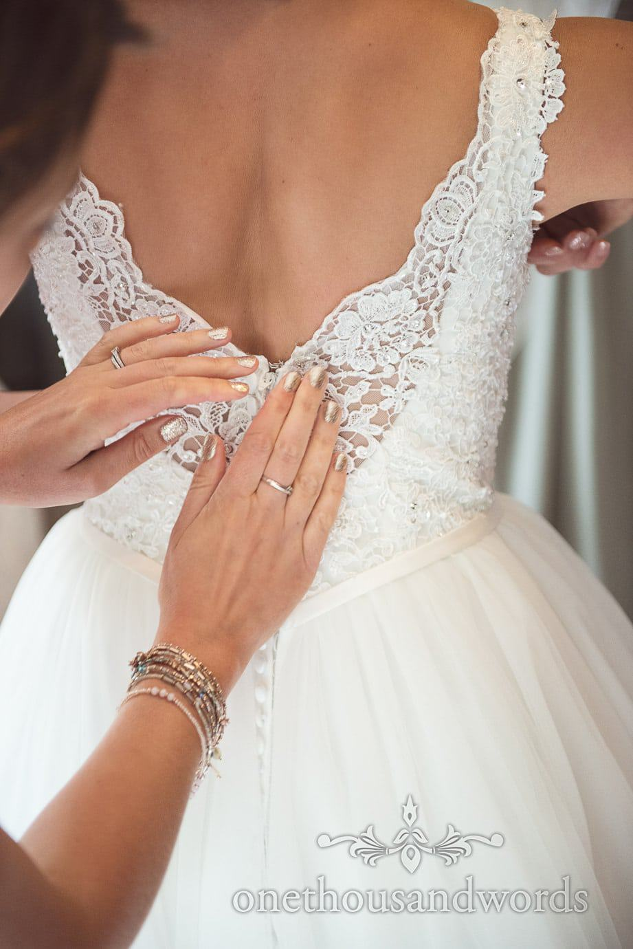 Stunning lace detailing on backless white A line wedding dress